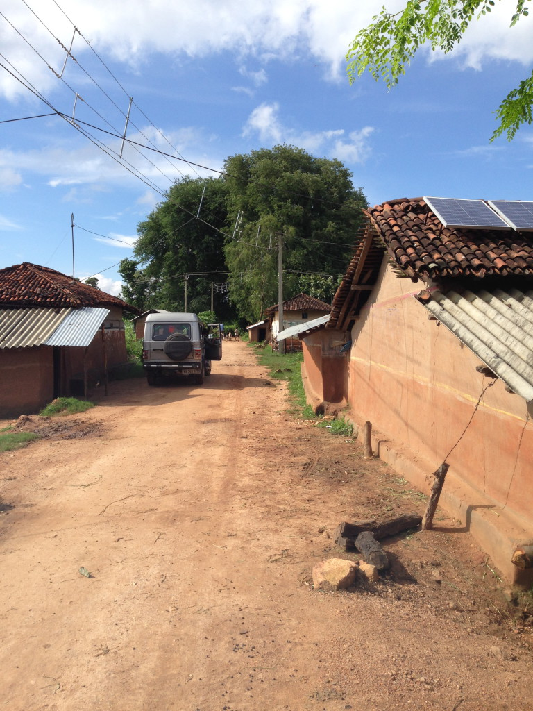 A Defunct grid electrification sits side by side community-owned solar minigrids